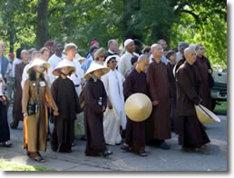 Thich Nhat Hanh walking with a group of people